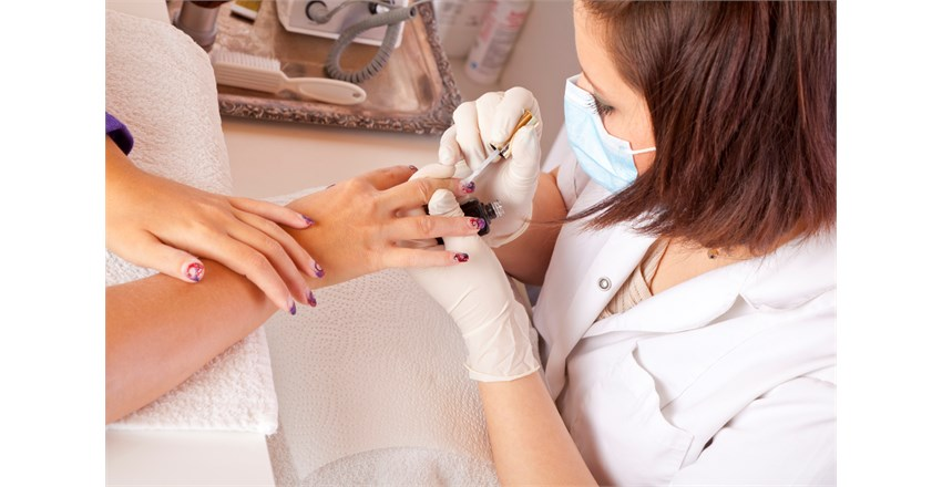 nail-designer-finishing-fingernails-177238749_1255x837.jpeg